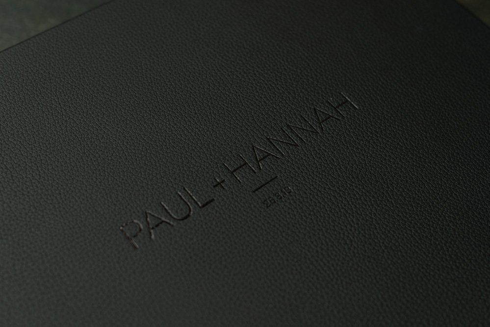 Black Leather Wedding Album with Personalised Embossing. Modern Design & Professionally Printed Photos. Sydney wedding album designer of Fine Art Albums & Coffee Table Books