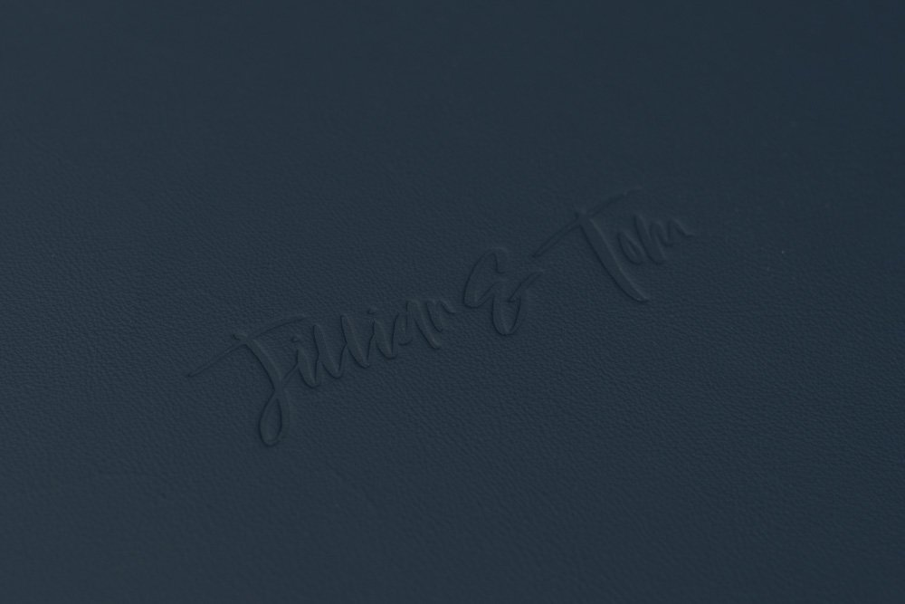 Leather Wedding Photo Album in Navy Blue with Custom Name Embossing - Close up of Personalised Embossing