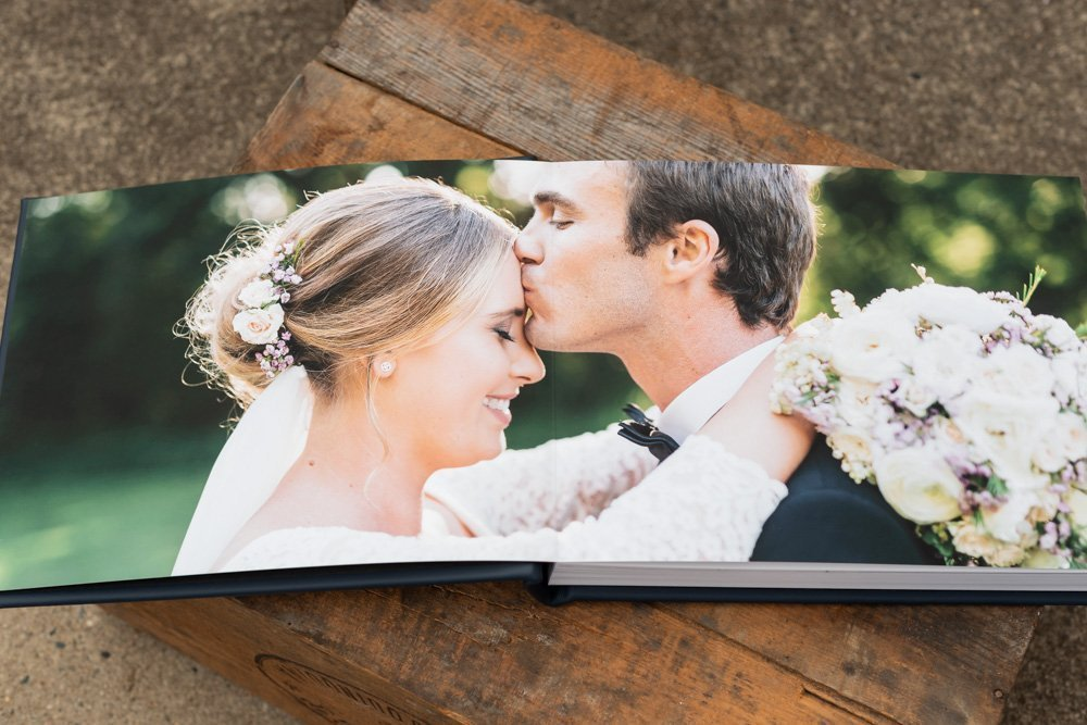 Leather Wedding Photo Album in Navy Blue with Custom Name Embossing - Spread from Bride & Groom's Portraits